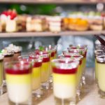 delicious-desserts-in-shot-glasses-on-buffet-table_1262-1797